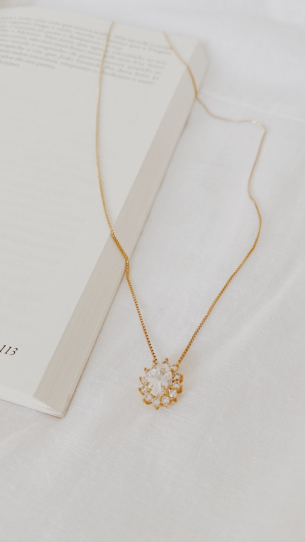 gold necklace on white paper