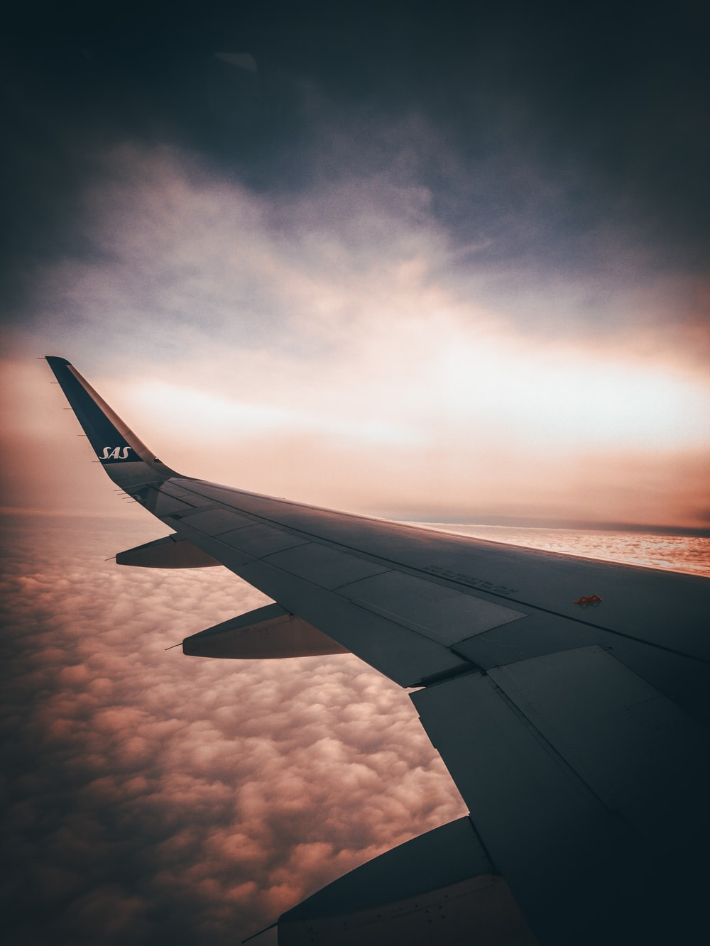 white airplane wing during sunset