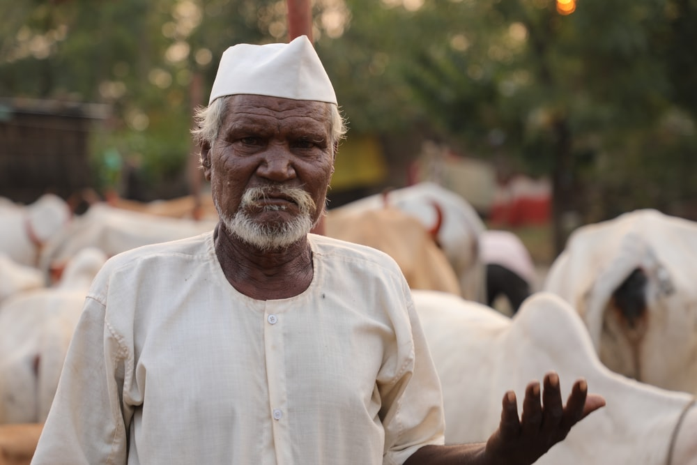 man in white thobe and white turban
