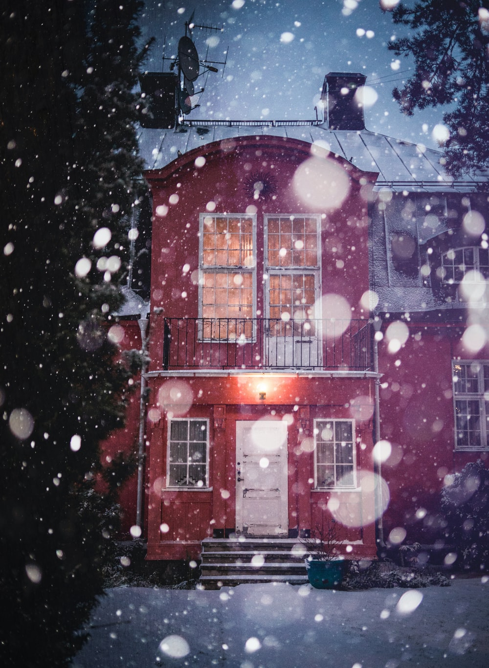 red and white house with snow on roof