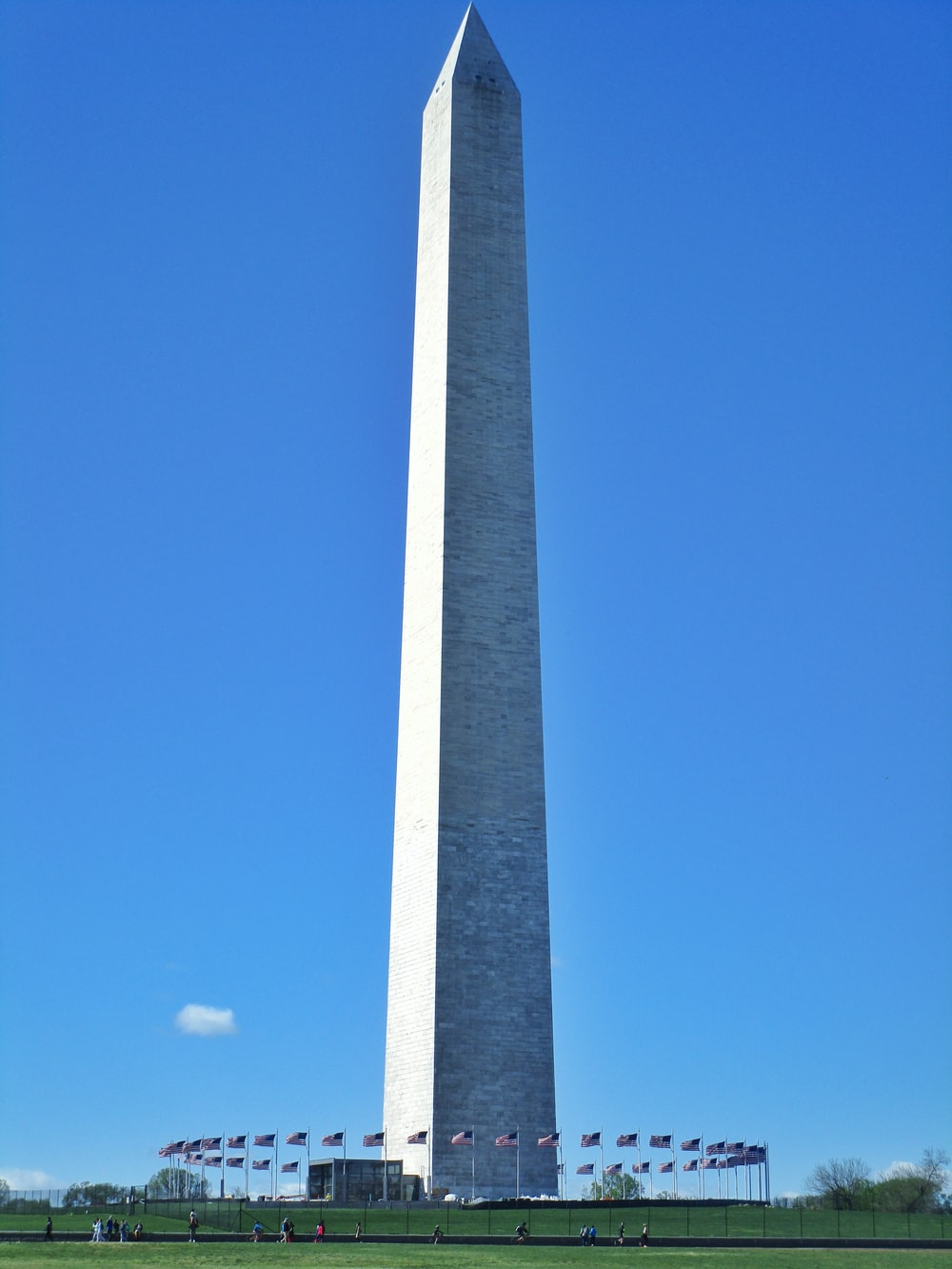 gray concrete tower under blue sky during daytime