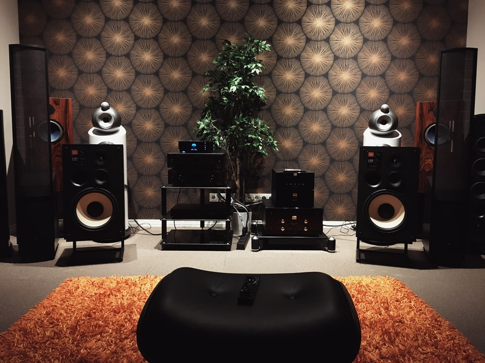 black and silver speakers on white table
