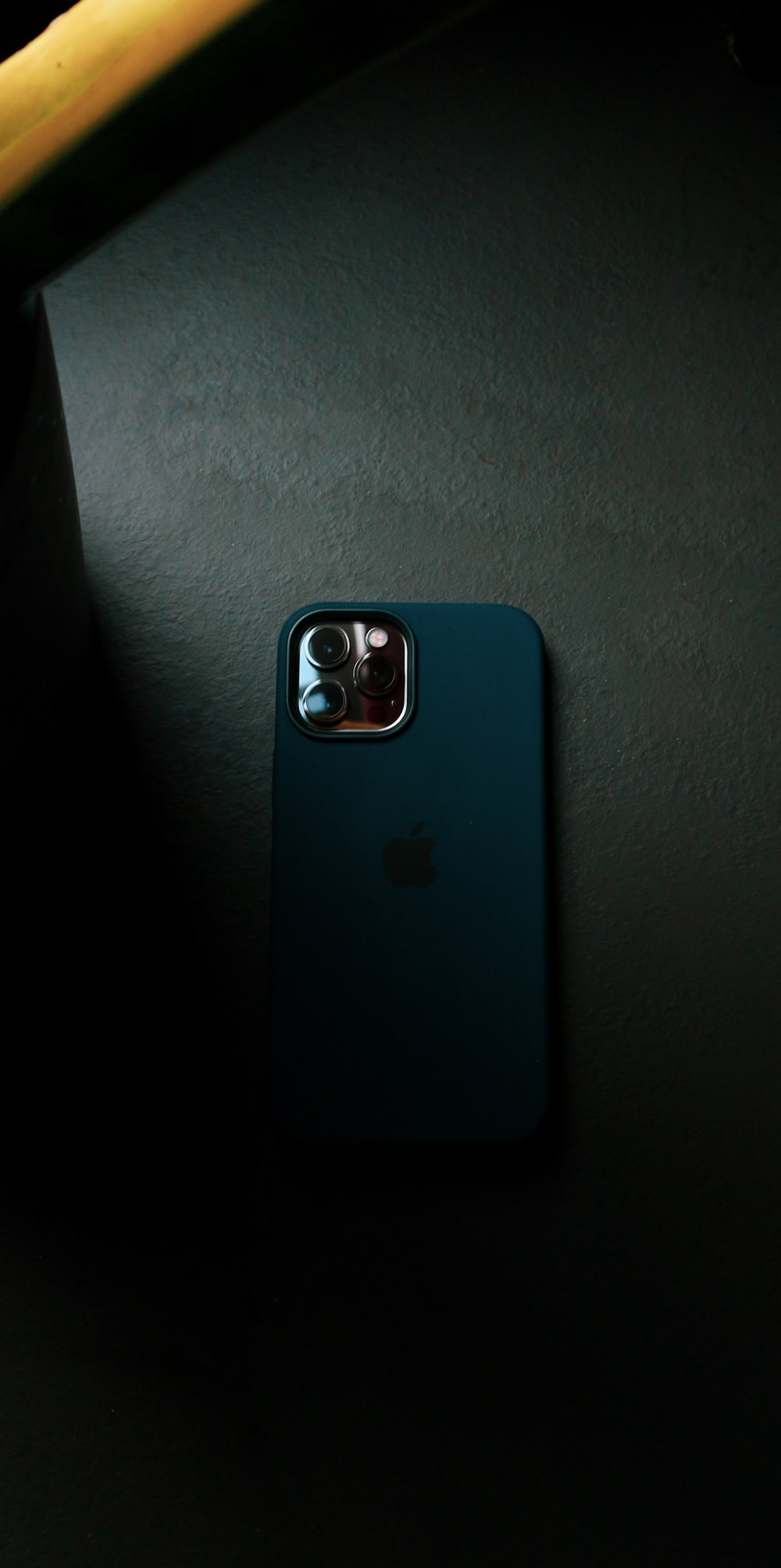 blue iphone case on gray textile