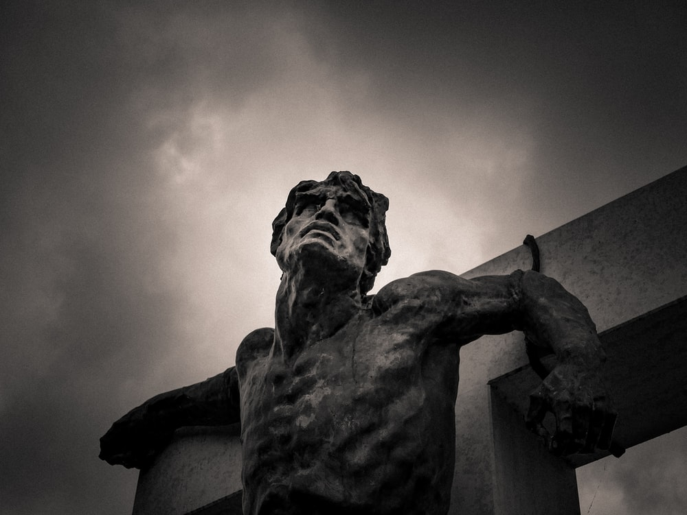grayscale photo of man statue