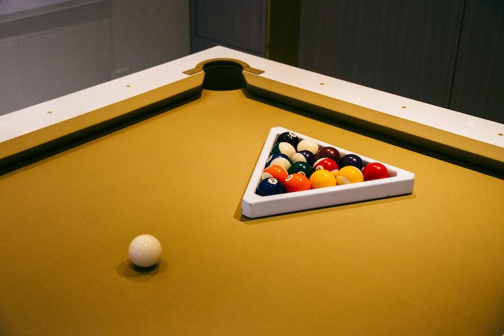 billiard balls on billiard table