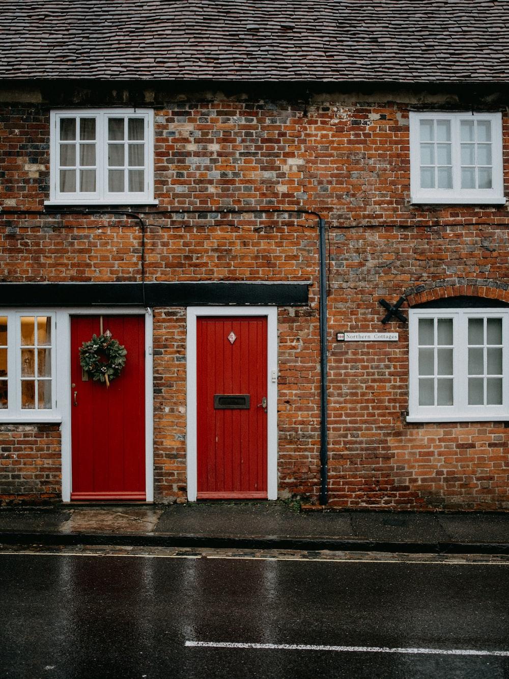 red wooden door on brown brick building