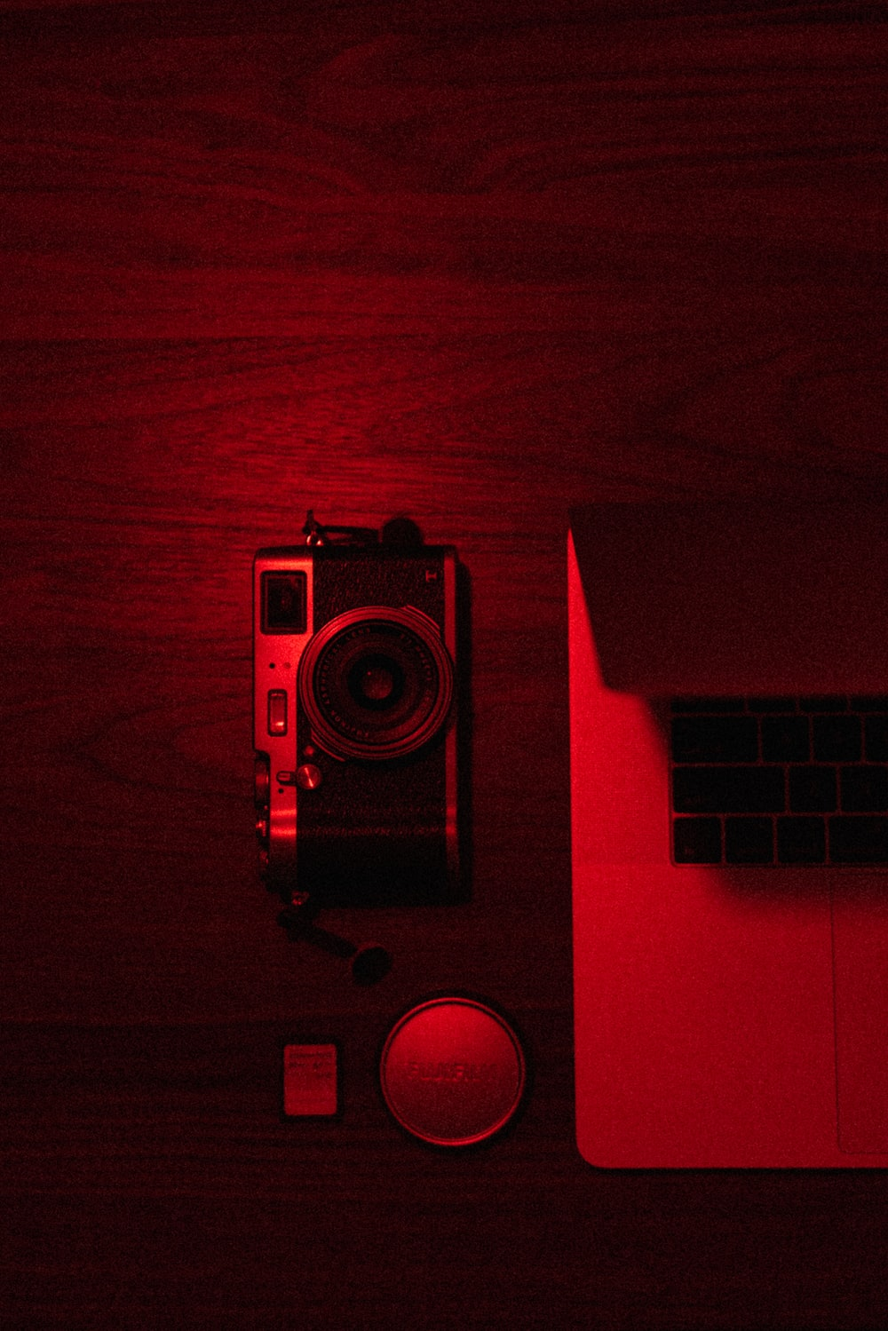 red and black camera on red surface