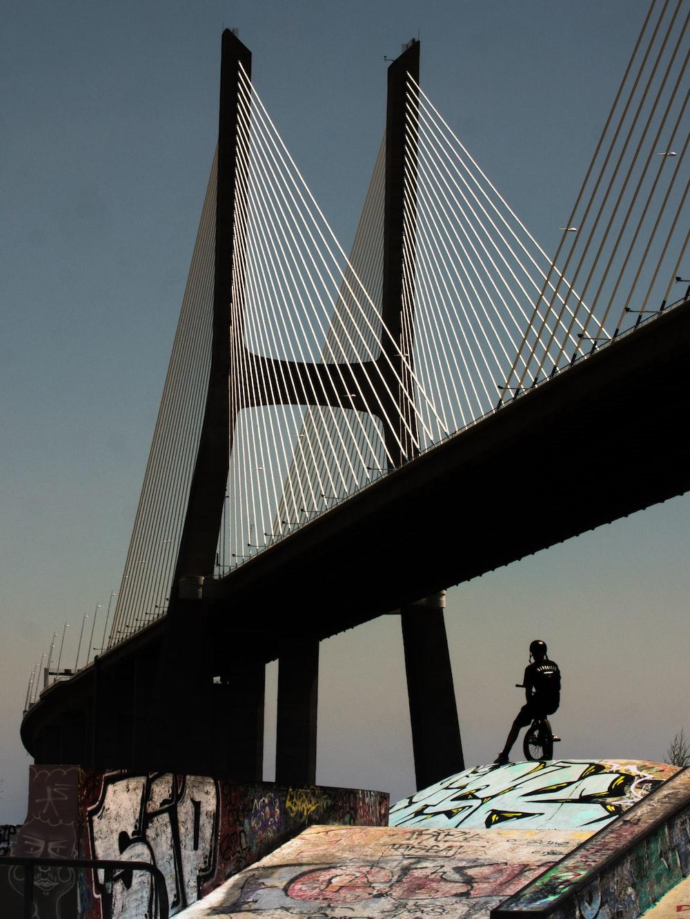 black metal bridge under white sky during daytime