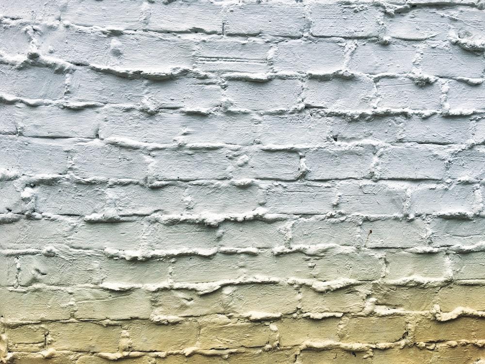 grey concrete brick wall during daytime