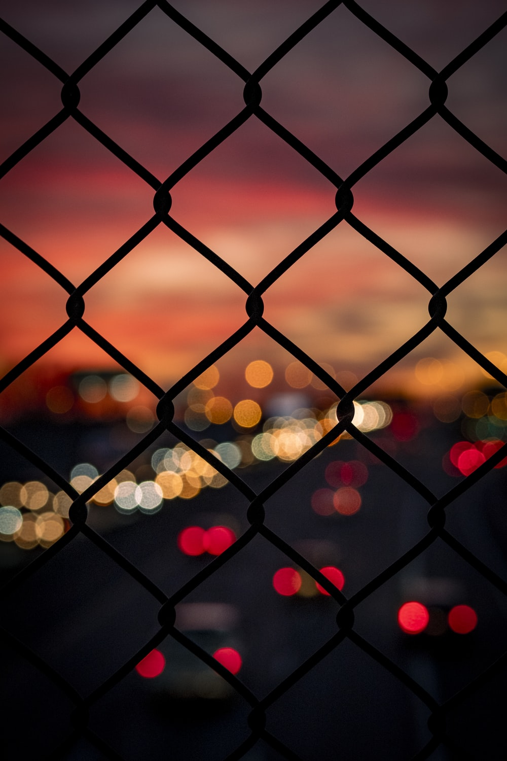 bokeh photography of chain link fence
