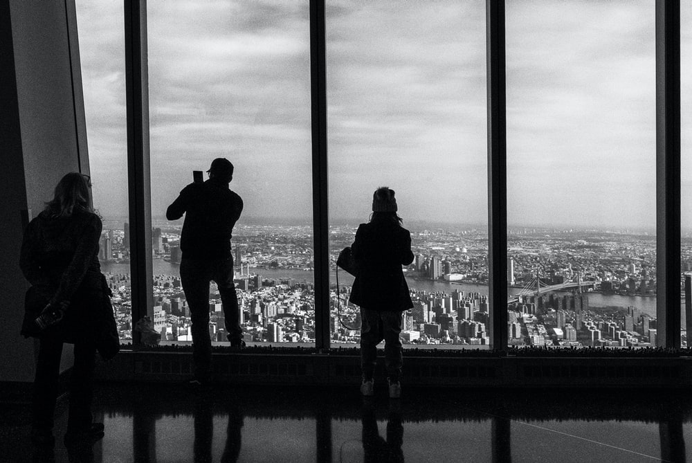 silhouette of 2 person standing on building