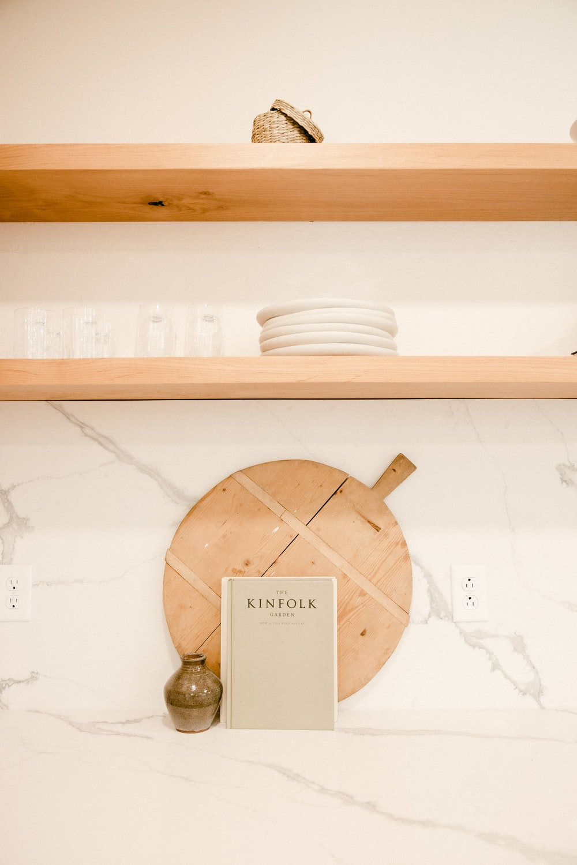 brown wooden round ornament on white wooden shelf