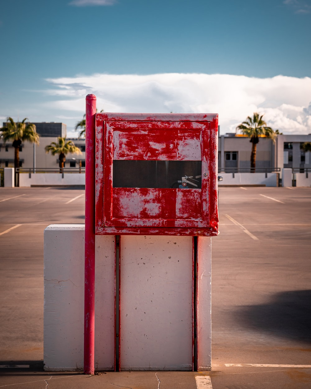 red and white post near road
