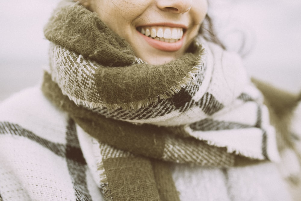 woman in white and black scarf