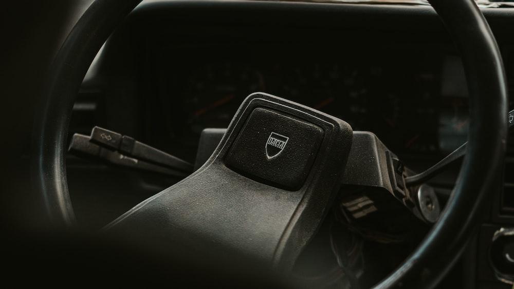 black honda steering wheel in close up photography