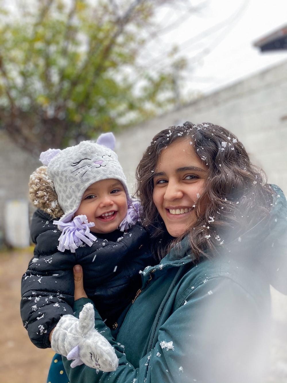 2 women smiling while taking photo