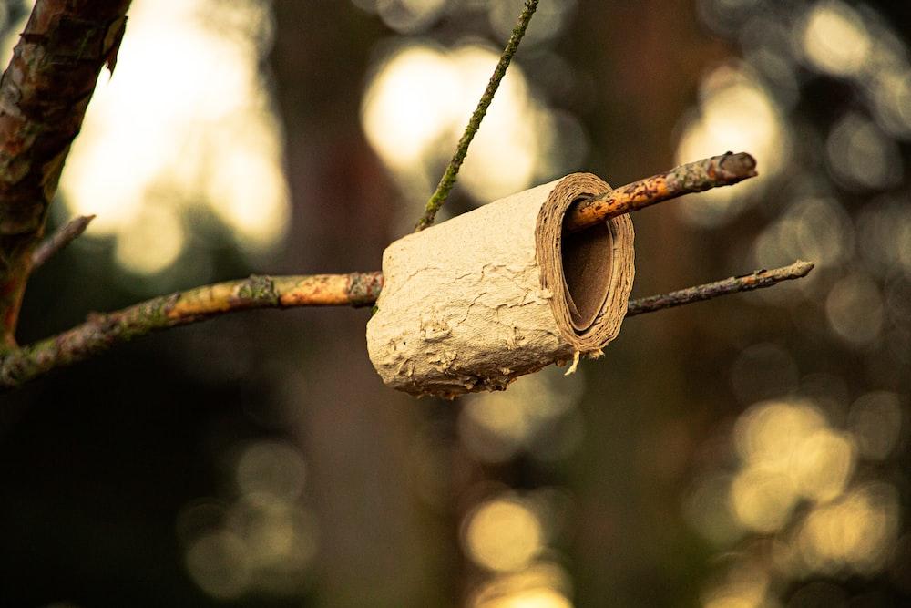brown wooden padlock on brown metal wire