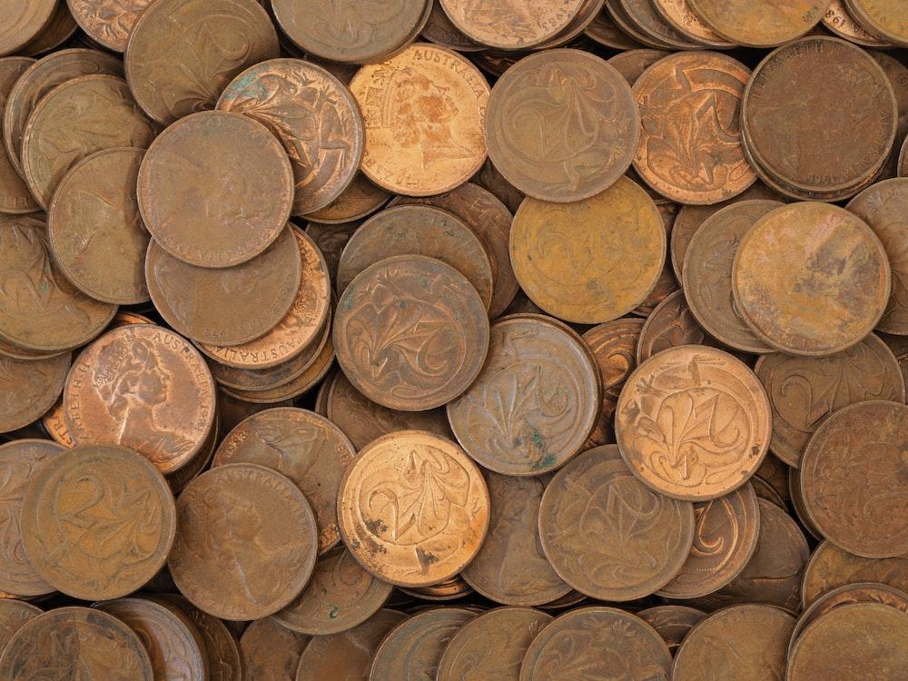 brown wooden round barrels on brown wooden floor