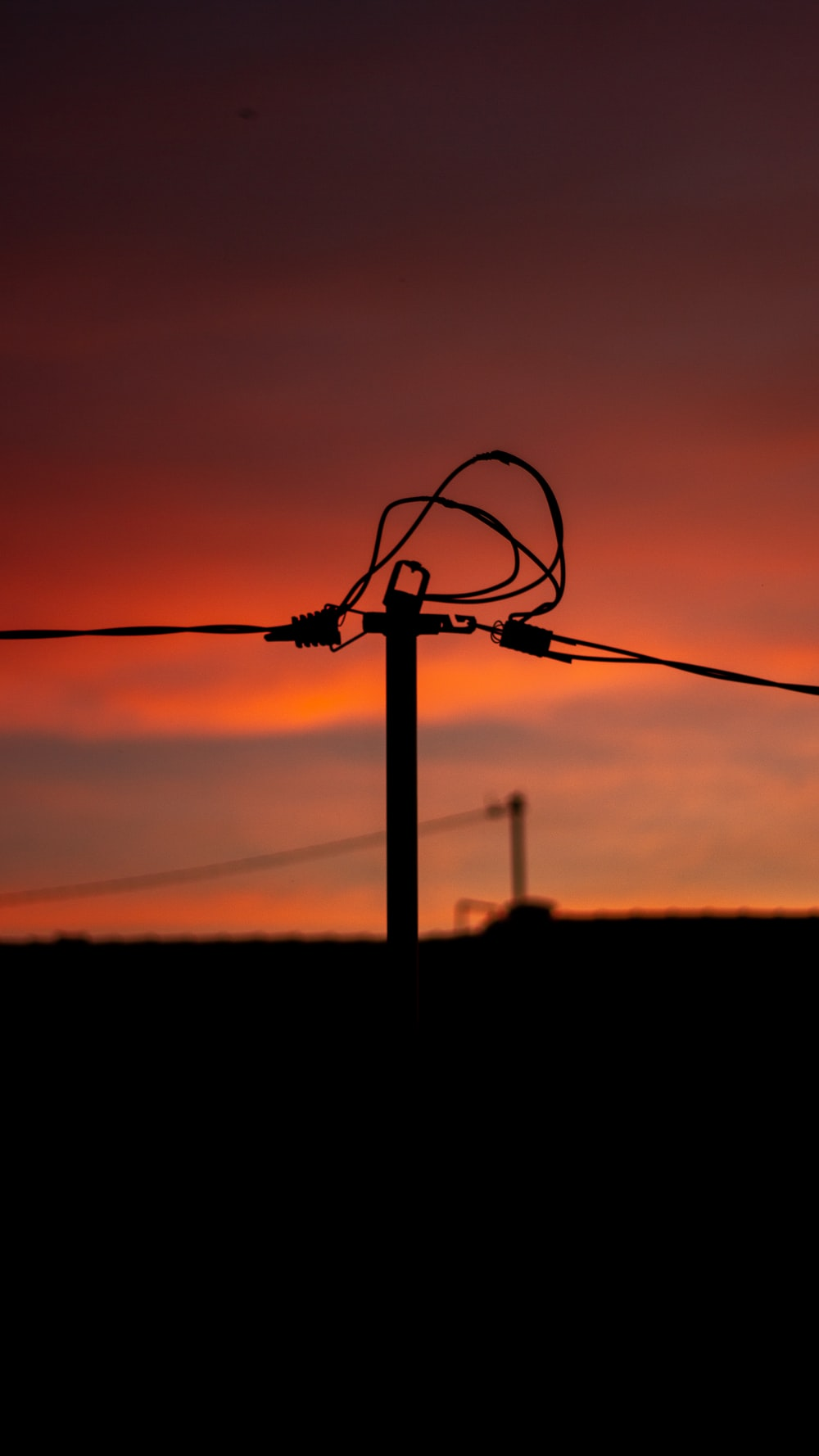 silhouette of a black wire during sunset