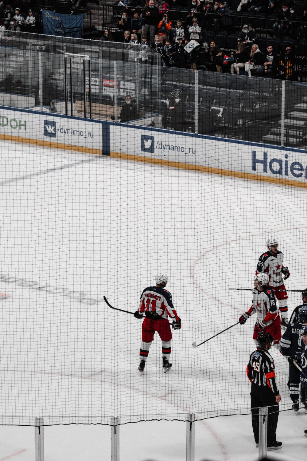 man in red and white hockey jersey playing hockey
