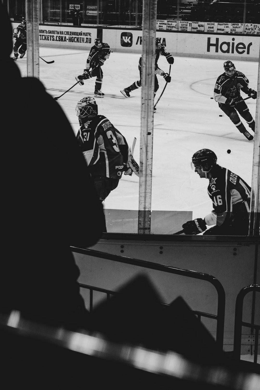 grayscale photo of 2 men playing hockey