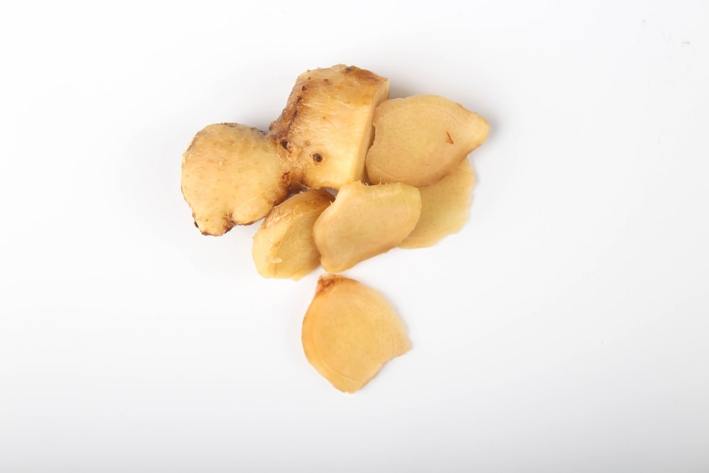 brown chips on white surface