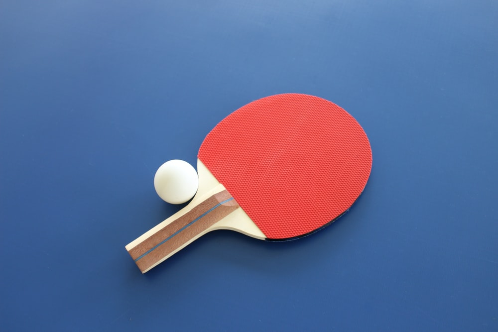 red and white ball on green surface