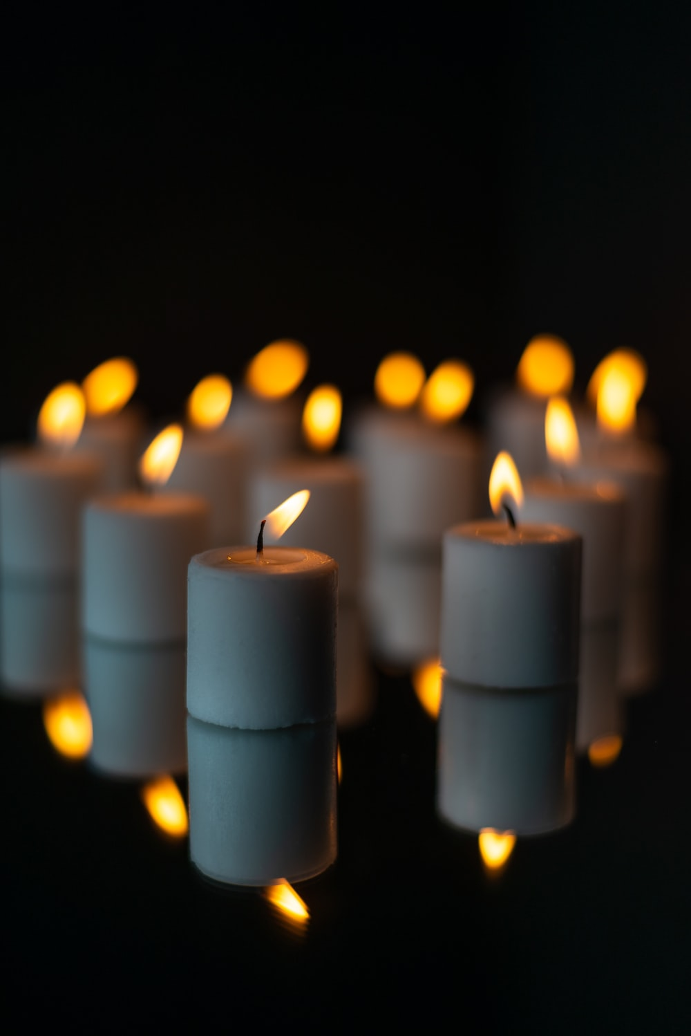 white pillar candles with fire