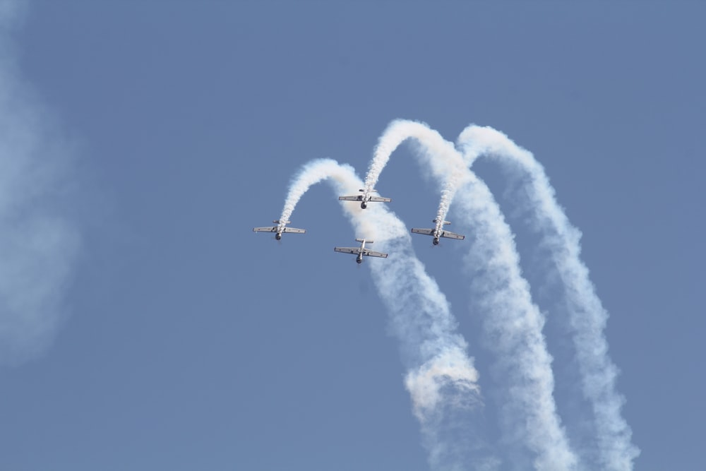 white jet plane in mid air