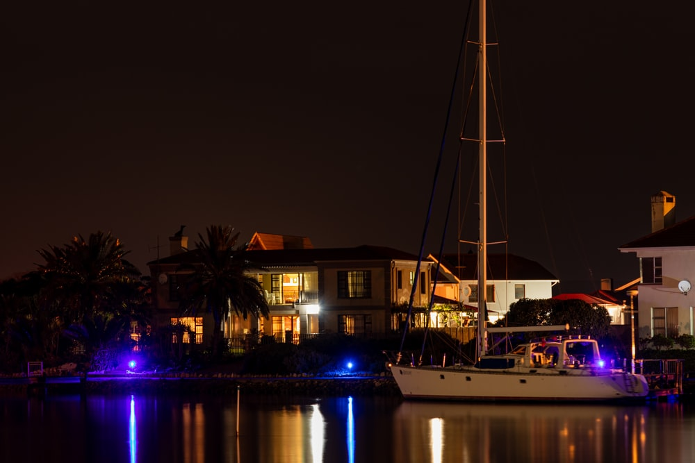 white boat on dock during night time