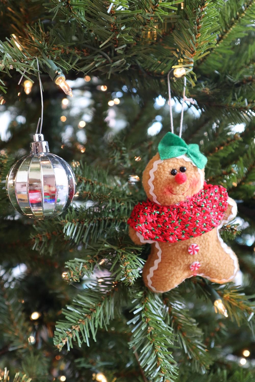 brown bear hanging ornament on green christmas tree