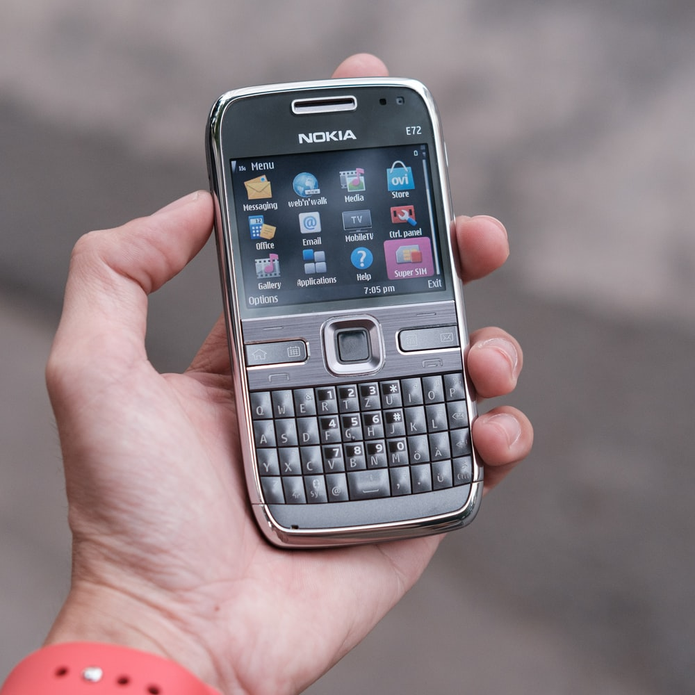 person holding gray nokia qwerty phone