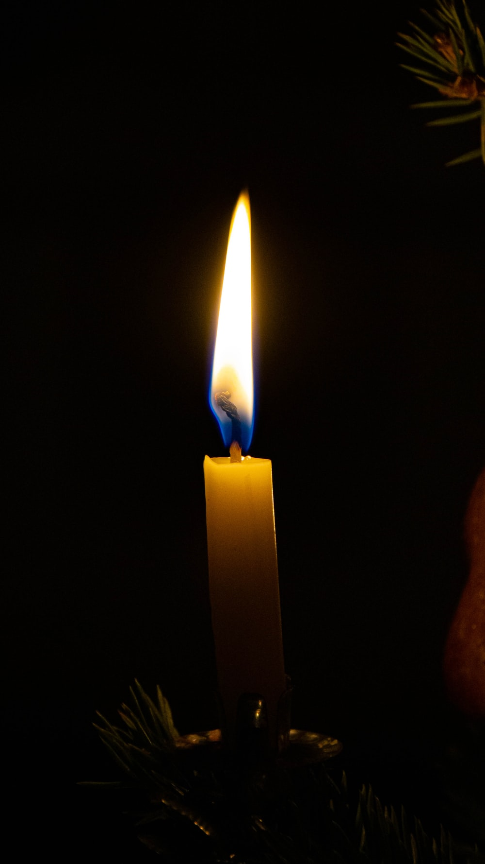 white candle in dark room