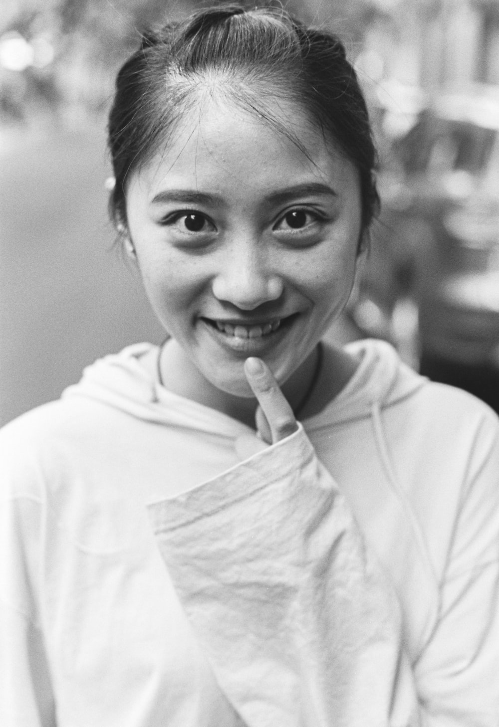 grayscale photo of smiling woman in white shirt