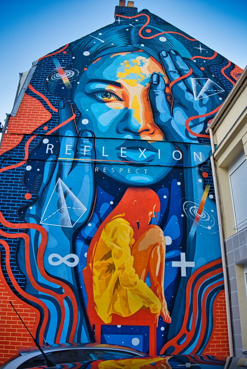 blue and yellow woman with wings graffiti