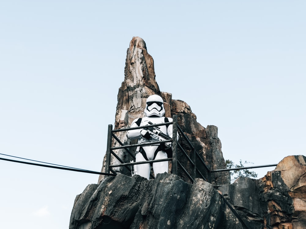 white and black concrete statue on top of gray rock
