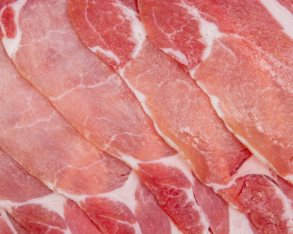 raw meat on white surface