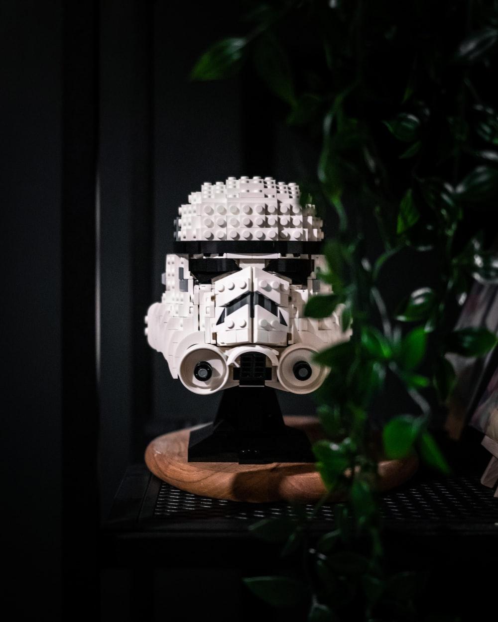 white and black robot figurine