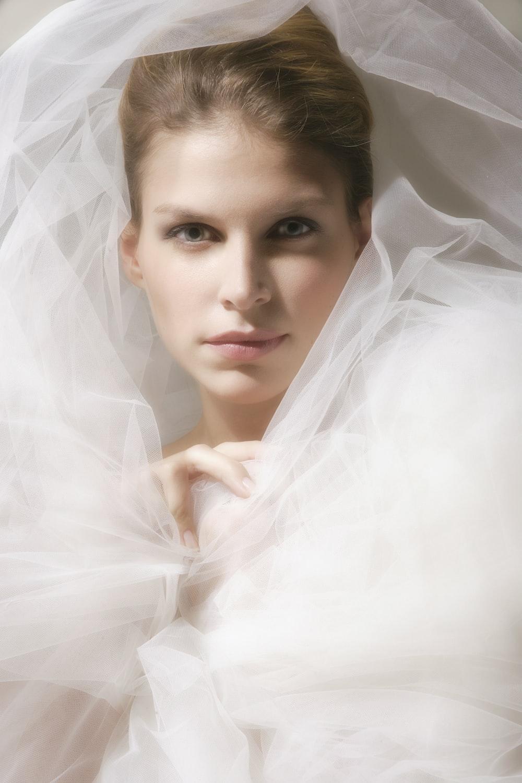 woman in white veil on white sheer textile