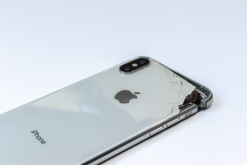 silver iphone 6 on white surface