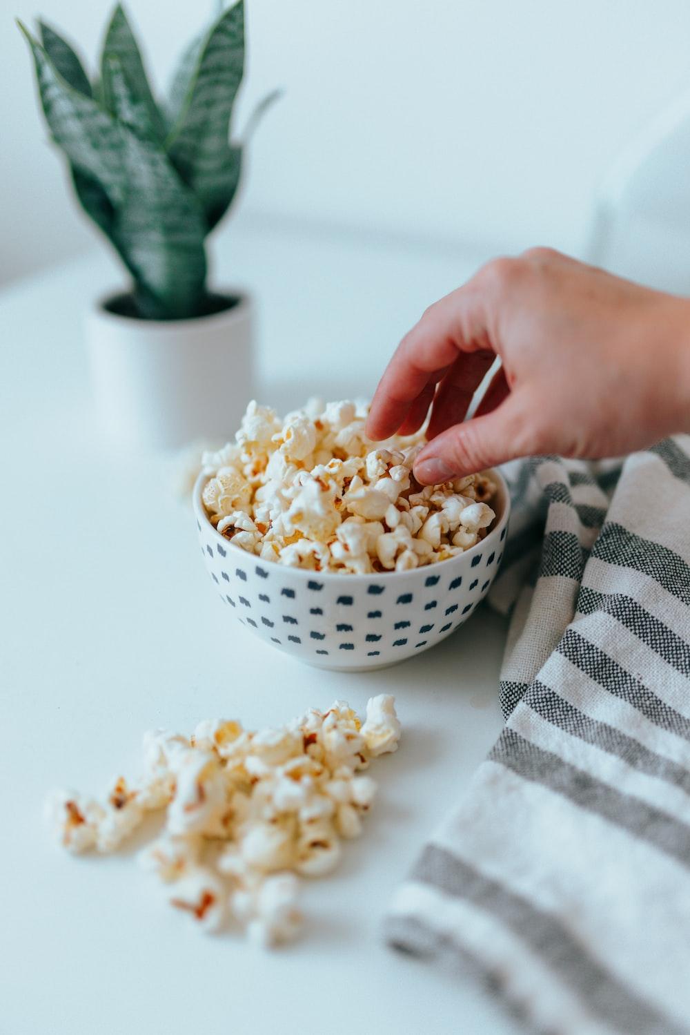 popcorn in white ceramic bowl