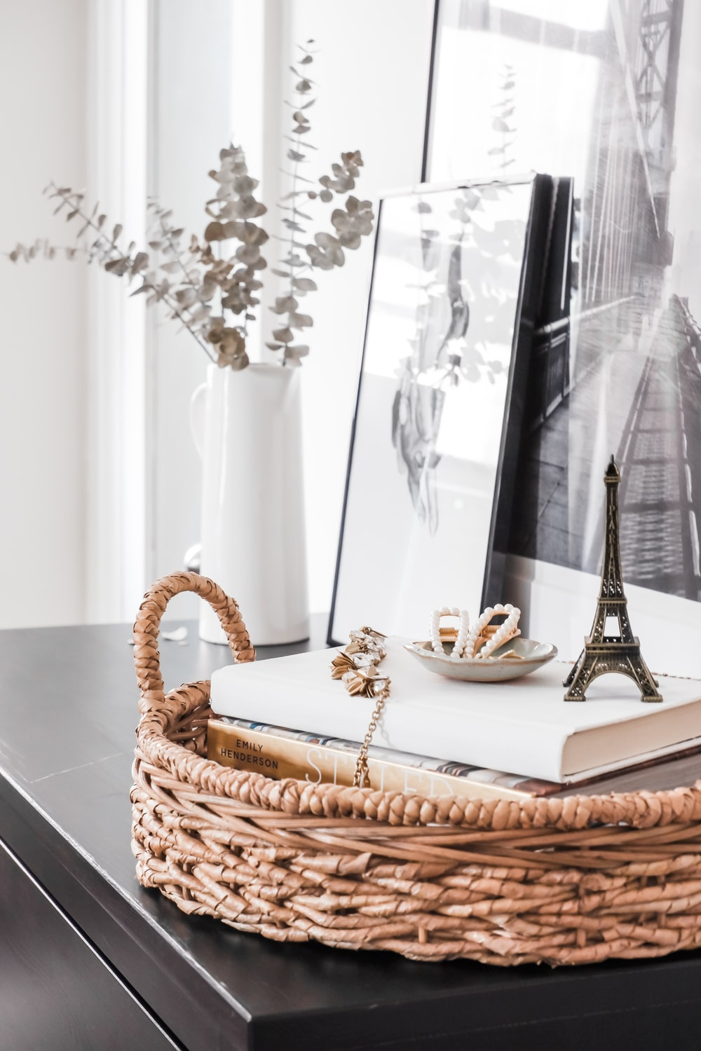 white and brown wicker basket on table