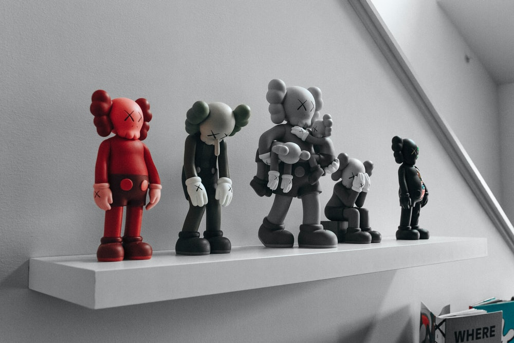 red and gray elephant figurines