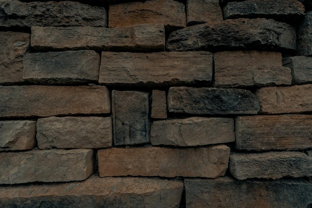 brown and gray brick wall
