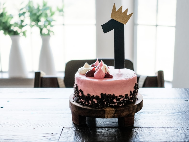 pink and brown cake on brown wooden table
