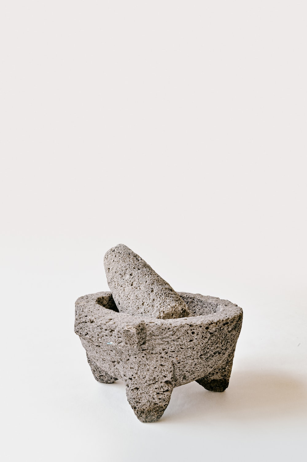 gray stone on white surface