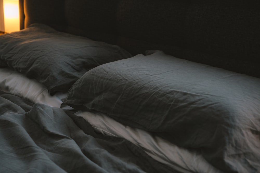 white bed pillow on bed