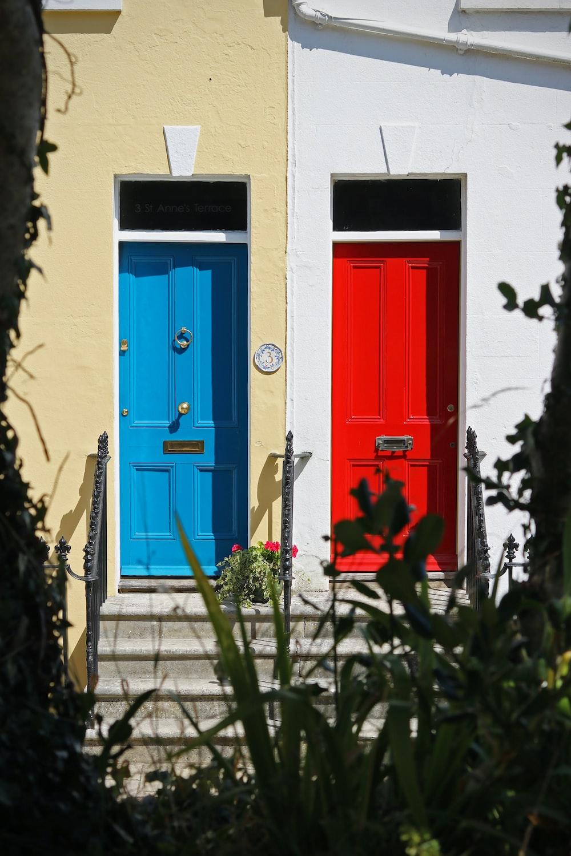 blue wooden door with red door