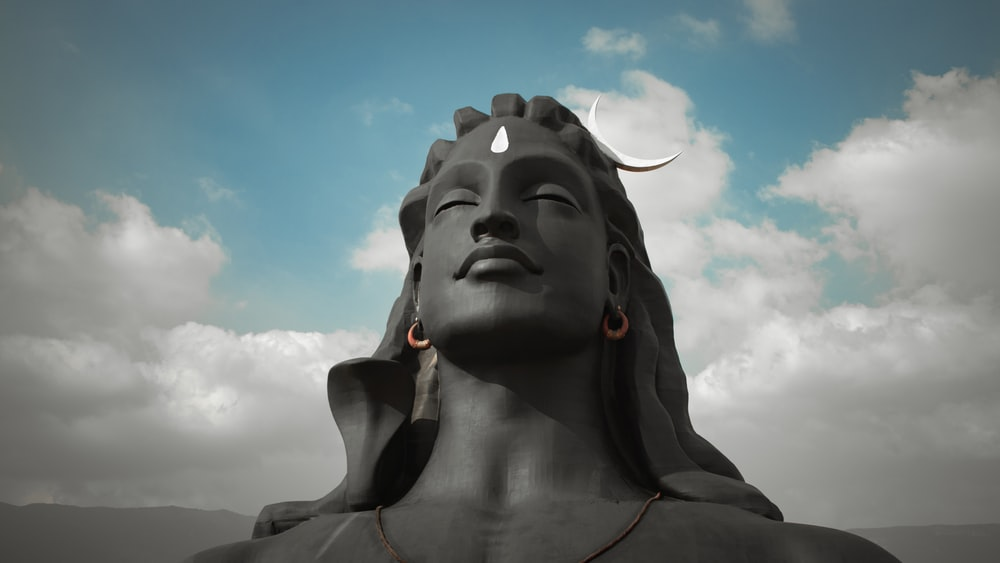 gray concrete statue under blue sky during daytime