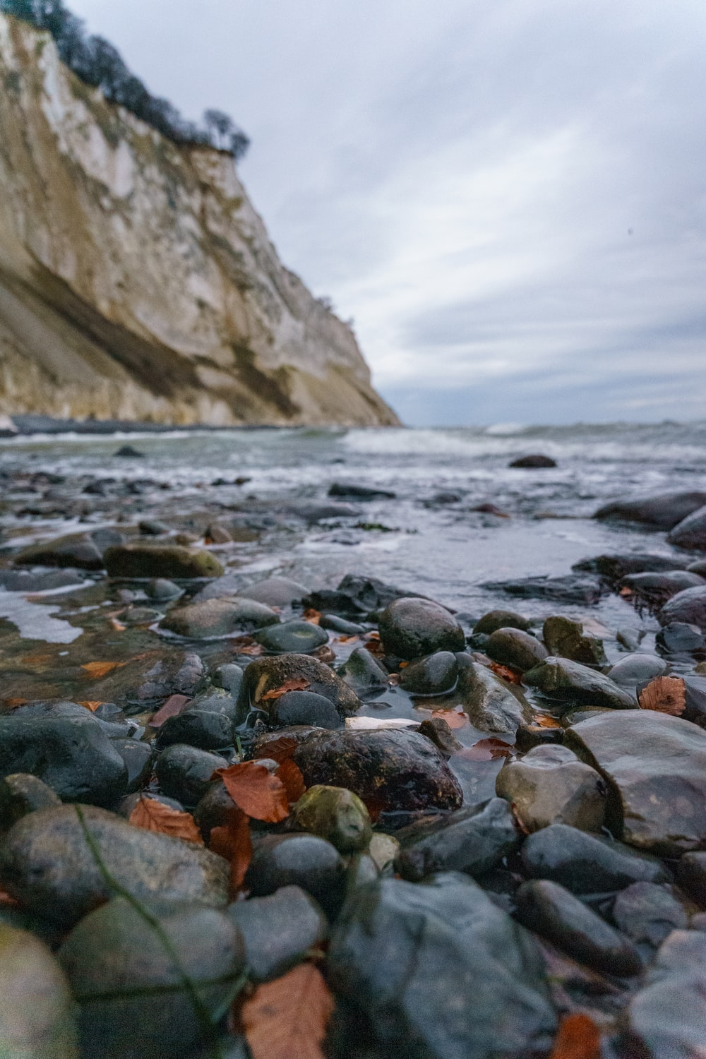 rocky shore with stones and water waves